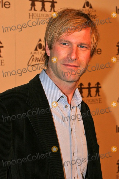 Aaron Eckhart Photo - Aaron Eckhart at the InStyle Magazine  AOL Host Online Auction to Benefit Hollygrove at Mortons Restaurant West Hollywood CA 11-15-04