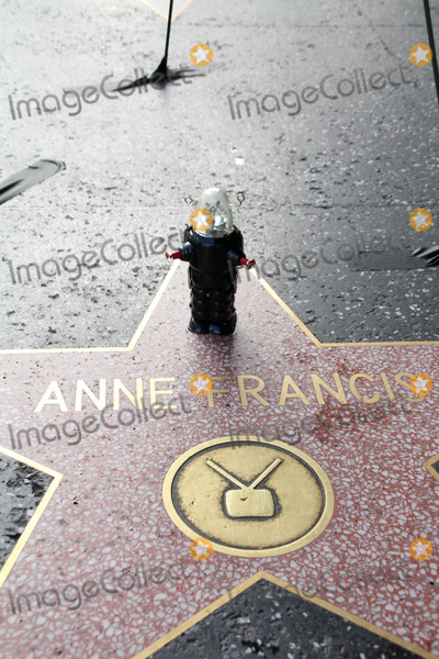 Anne Francis Photo - Anne Francis Star with a small Robby The Robot placed there by a fanto commemorate her passing today Hollywood Walk of Fame Hollywood CA 01-03-2011
