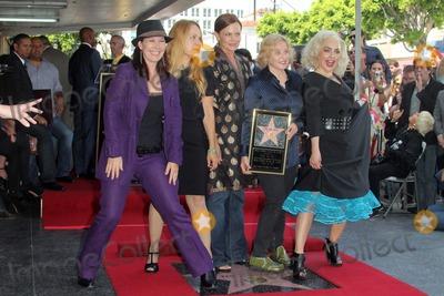 Belinda Carlisle Photo - Kathy Valentine Charlotte Caffey Belinda Carlisle Gina Schock and Jane Wiedlinat the Go-Gos induction into the Hollywood Walk of Fame Hollywood CA 08-11-11
