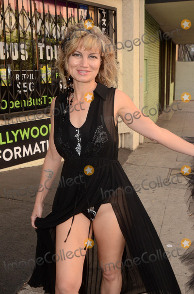 Fancy Photo - Rena Riffelthe Showgirls actress is spotted in a fancy dress out on the street in Hollywood CA 05-15-18