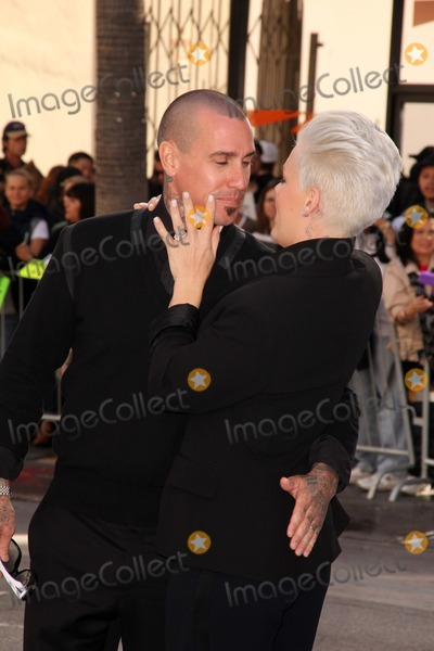Alecia Pink Moore Photo - Carey Hart Alecia Pink Mooreat the Happy Feet Two World Premiere Chinese Theater Hollywood CA 11-13-11