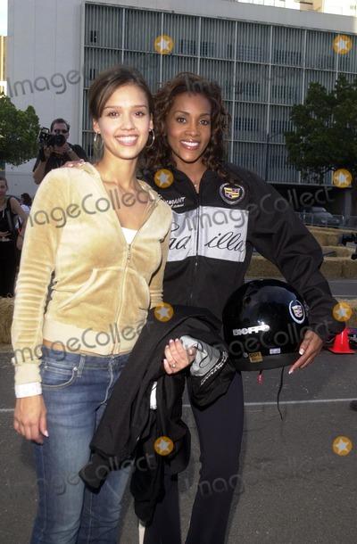 Vivica A Fox Photo - Jessica Alba and Vivica A Fox at the Cadillac Super Bowl Grand Prix San Diego CA 01-25-03