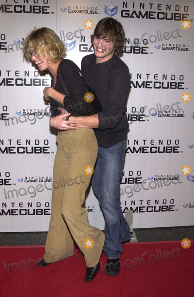 Ashley Scott Photo -  ASHTON KUTCHER and ASHLEY SCOTT at the launch party for the new Nintendo Game Cube system sponsored by MTV in Hollywood 10-03-01
