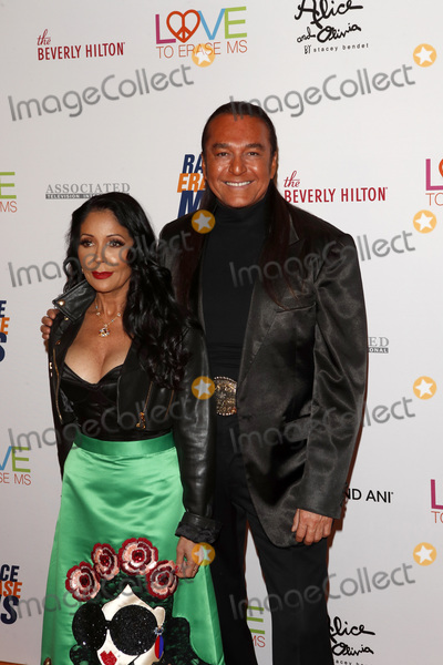 Apollonia Photo - LOS ANGELES - MAY 10  Nick Chavez Apollonia Kotero at the Race to Erase MS Gala at the Beverly Hilton Hotel on May 10 2019 in Beverly Hills CA