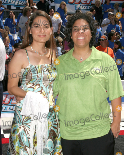 Angela Robinson Photo - Angela Robinson (Director)and her Guest AlexHerbie Fully Loaded PremiereEl Capitan TheaterLos Angeles CAJune 19 2005
