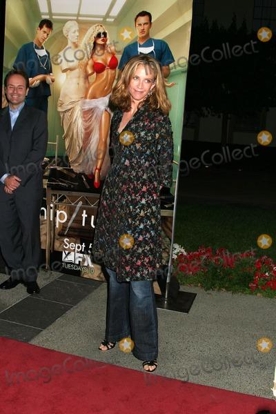 Ally Walker Photo - Ally WalkerNip  Tuck Season Premiere PartyParamount TheaterLos Angeles CAAugust 25 2006