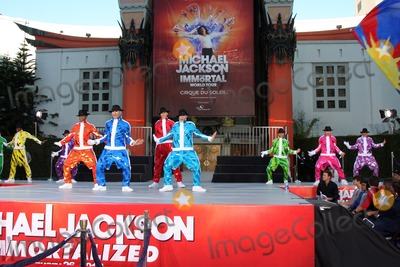 The Jacksons Photo - LOS ANGELES - JAN 26  Cirque du Soleil Immortal Troupe perform at the Michael Jackson Immortalized  Handprint and Footprint Ceremony at Graumans Chinese Theater on January 26 2012 in Los Angeles CA