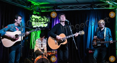 Alex Kapranos Photo - BALA CYNWYD PA - OCTOBER 19  (L to R) Nick McCarthy Paul Thomson Alex Kapranos and Robert Hardy of Scottish Indie Rock Band Franz Ferdinand Perform at Radio 1045s Performance Theatre on October 19 2013 in Bala Cynwyd Pennsylvania (Photo by Paul J FroggattFamousPix)