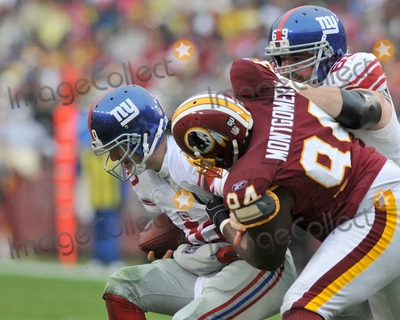 Anthony Montgomery Photo - RESTRICTED NO NEW YORK OR NEW JERSEY NEWSPAPERS WITHIN A 75 MILE RADIUS OF NYCLandover MD - November 30 2008 -- New York Giants quarterback Eli Manning (10) is sacked by Washington Redskins defender Anthony Montgomery (94) in the first quarter at FedEx Field Photo by Ron Sachs-CNP-PHOTOlinknet