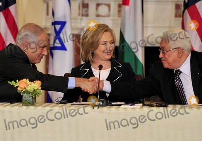 ABBA Photo - United States Secretary of State Hillary Rodham Clinton center smiles as Prime Minister Benjamin Netanyahu of Israel left and Mahmoud Abbas of the Palestinian Authority shake hands following their remarks at the start of the Relaunch of Direct Negotiations Between the Israelis and Palestinians in the Benjamin Franklin Room of the US Department of State on Thursday September 2 2010  Credit Ron Sachs  CNP(RESTRICTION NO New York or New Jersey Newspapers or newspapers within a 75 mile radius of New York City)