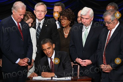 Harry Reid Photo - United States President Barack Obama signs the Dodd-Frank Wall Street Reform and Consumer Protection Act at the Ronald Reagan Building Wednesday July 21 2010 in Washington DC The bill is the strongest financial reform legislation since the Great Depression and also creates a consumer protection bureau that oversees banks on mortgage lending and credit card practices Also pictured (L-R) are Vice President Joe Biden Speaker of the House Nancy Pelosi (D-CA) Senate Majority Leader Harry Reid (D-NV) Rep Maxine Waters (D-CA) Sen Chris Dodd (D-CT) and Rep Barney Frank (D-MA) Photo by Win McNameePool-CNP-PHOTOlinknet