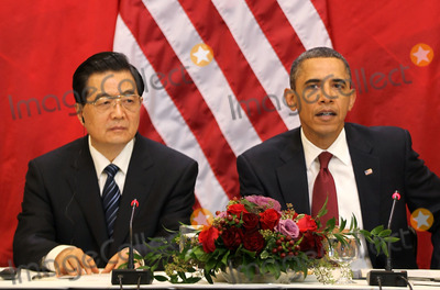 Alex Wong Photo - WASHINGTON DC - JANUARY 19  (AFP OUT) US President Barack Obama (R) speaks as Chinese President Hu Jintao (L) listens as they meet with US and Chinese business leaders and CEOs at the Eisenhower Executive Office Building January 19 2011 in Washington DC Obama and Hu met in the Oval Office earlier in the day and will attend a State dinner this evening Photo by  Alex WongPoolCNP-PHOTOlinknet