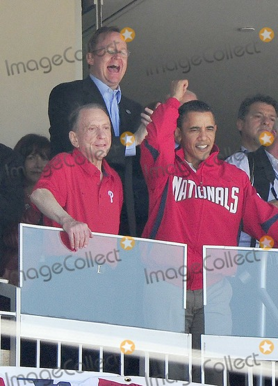 Arlen Specter Photo - Washington DC - April 5 2010 -- United States President Barack Obama celebrates the third out in the top of the first inning after throwing out the first ball to open the 2010 Major League season in Washington DC as the Philadelphia Phillies visit the Washington Nationals at Nationals Park on Monday April 5 2010  With the President are US Senator Arlen Specter (Democrat of Pennsylvania) left and White House Press Secretary Robert Gibbs topPhoto by Ron Sachs-CNP-PHOTOlinknet