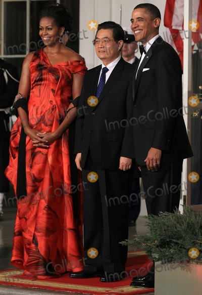 Alex Wong Photo - WASHINGTON DC - JANUARY 19  US President Barack Obama (R) and first lady Michelle Obama (L) welcome Chinese President Hu Jintao (C) for a State dinner at the White House January 19 2011 in Washington DC Obama and Hu met in the Oval Office earlier in the day  Photo by  Alex WongPoolCNP-PHOTOlinknet