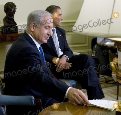 Benjamin Netanyahu Photo - Washington DC - May 18 2009 -- Prime Minister Benjamin Netanyahu looks over his notes as he awaits the arrival of the press pool during his meeting with United States President Barack Obama in the Oval Office of the White House Digital Photo by Ron Sachs-CNP-PHOTOlinknet