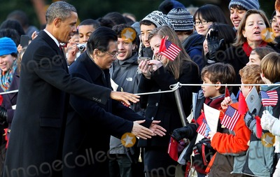Mark Wilson Photo - WASHINGTON DC - JANUARY 19 (AFP OUT) US President Barack Obama (L) greets school children with Chinese President Hu Jintao during a State arrival ceremony on the South Lawn of the White House January 19 2011 in Washington DC Obama and Hu are scheduled to meet in the Oval Office later in the day hold a joint press conference and attend a State dinner Photo by  Mark WilsonPoolCNP-PHOTOlinknet