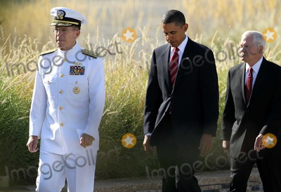 Alex Wong Photo - Chairman of the Joint Chiefs of Staff Admiral Mike Mullen left United States President Barack Obama center and Secretary of Defense Robert Gates right arrive for an event to mark the anniversary of the 911 terrorist attacks at the Pentagon Memorial Saturday September 11 2010 in Arlington Virginia Obama delivered remarks laid a wreath and greeted with victims families during the event on the 9th anniversary of the tragedy Photo by Alex WongPoolCNP-PHOTOlinknet