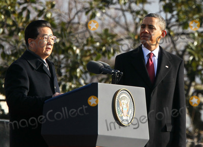 Alex Wong Photo - WASHINGTON DC - JANUARY 19 (AFP OUT) Chinese President Hu Jintao (L) speaks as US President Barack Obama (R) looks on during a state arrival ceremony at the South Lawn of the White House January 19 2011 in Washington DC Hu and President Obama will hold a press conference at the White House later todayPhoto by  Alex WongPoolCNP-PHOTOlinknet