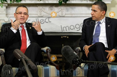 Alex Wong Photo - United States President Barack Obama (R) shakes hands with President Mauricio Funes (L) of El Salvador during their meeting in the Oval Office at the White House on Monday March 8 2010 in Washington DC Funes was the first Central American leader that Obama has met since he took office  Photo by Alex WongPool-CNP-PHOTOlinknet