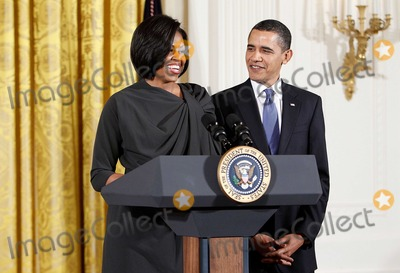 Alex Wong Photo - United States President Barack Obama (R) looks at his wife first lady Michelle Obama (L) as she speaks during a reception in honor of International Womens Day at the East Room of the White House Monday March 8 2010 in Washington DC The reception honored women from around the world and their achievements  Photo by Alex WongPool-CNP-PHOTOlinknet