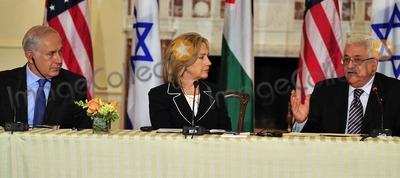Benjamin Netanyahu Photo - United States Secretary of State Hillary Rodham Clinton center listens as President Mahmoud Abbas of the Palestinian Authority right makes remarks at the Relaunch of Direct Negotiations Between the Israelis and Palestinians in the Benjamin Franklin Room of the US Department of State on Thursday September 2 2010  Prime Minister Benjamin Netanyahu is at leftCredit Ron Sachs  CNP(RESTRICTION NO New York or New Jersey Newspapers or newspapers within a 75 mile radius of New York City)