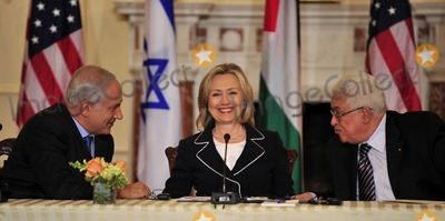 Benjamin Netanyahu Photo - United States Secretary of State Hillary Rodham Clinton center smiles as Prime Minister Benjamin Netanyahu of Israel left and Mahmoud Abbas of the Palestinian Authority share some thoughts following their remarks at the start of the Relaunch of Direct Negotiations Between the Israelis and Palestinians in the Benjamin Franklin Room of the US Department of State on Thursday September 2 2010  Credit Ron Sachs  CNP(RESTRICTION NO New York or New Jersey Newspapers or newspapers within a 75 mile radius of New York City)