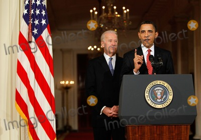 Alex Wong Photo - United States President Barack Obama (R) speaks as Vice President Joseph Biden (L) listens at the White House after the US House of Representatives passed the health care reform legislation March 21 2009 in Washington DC The proposed legislation has become the signature piece of Obamas domestic policy agenda and has eluded US presidents dating back to Theodore Roosevelt Photo by Alex WongPool-CNP-PHOTOlinknet