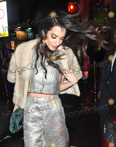 Amal Alamuddin Photo - Photo by KGC-172starmaxinccomSTAR MAXCopyright 2015ALL RIGHTS RESERVEDTelephoneFax (212) 995-119612315Amal Alamuddin Clooney is seen leaving a Christmas party(London England UK)