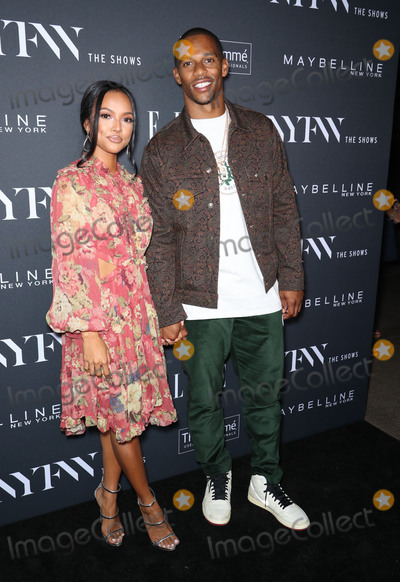 Karrueche Tran Photo - Photo by John NacionstarmaxinccomSTAR MAXCopyright 2018ALL RIGHTS RESERVEDTelephoneFax (212) 995-11969518Karrueche Tran and Victor Cruz at the E ELLE  IMG Celebration To Kick-Off New York Fashion Week (NYFW) The Shows at The Pool in New York City(NYC)