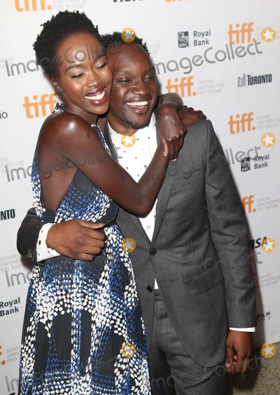 Arnold Oceng Photo - Photo by KGC-146starmaxinccomSTAR MAX2014ALL RIGHTS RESERVEDTelephoneFax (212) 995-11969714Kuoth Wiel and Arnold Oceng at the premiere of The Good Lie during the Toronto International Film Festival(Toronto Canada)