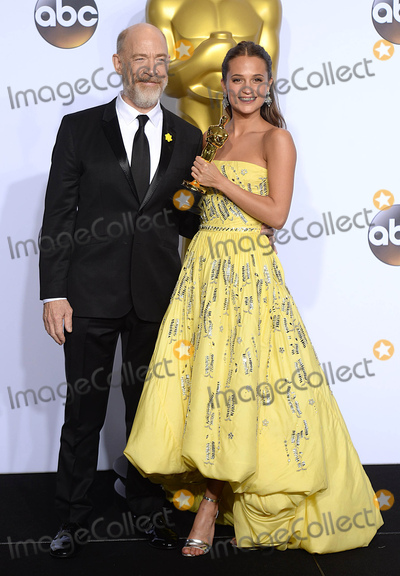 J K Simmons Photo - Photo by PDstarmaxinccomSTAR MAXCopyright 2016ALL RIGHTS RESERVEDTelephoneFax (212) 995-119622816Alicia Vikander with The Oscar for Best Supporting Actress for The Danish Girl and JK Simmons at the 88th Annual Academy Awards (Oscars)(Hollywood CA USA)