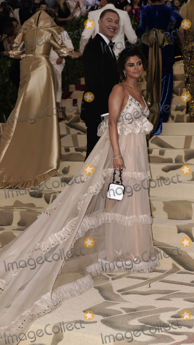 Selena Gomez Photo - Photo by XPXstarmaxinccomSTAR MAXCopyright 2018ALL RIGHTS RESERVEDTelephoneFax (212) 995-11965718Selena Gomez and Stuart Vevers at the 2018 Costume Institute Benefit Gala celebrating the opening of Heavenly Bodies Fashion and the Catholic Imagination(The Metropolitan Museum of Art NYC)
