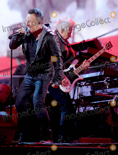 Adam Clayton Photo - Photo by Dennis Van TinestarmaxinccomSTAR MAX2014ALL RIGHTS RESERVEDTelephoneFax (212) 995-119612114Bruce Springsteen and Adam Clayton at a free benefit concert honoring World AIDS Day(Times Square)