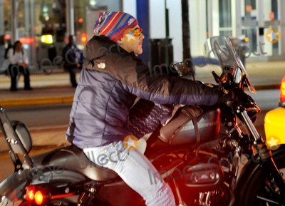 Alejandro Sanz Photo - EXCLUSIVE Its a dogs life At least for Spanish singer Alejandro Sanzs pup The Grammy award winner opted for a ride on his Harley-Davidson motorcycle and brought along his little pampered pet for the journey And on the chilly Miami winter night Sanz who wore a hat and jacket himself even bundled up his pooch in a sweater and goggles and safely had him seated in the front on a comfy doggy cushion Miami FL 021311Fees must be agreed prior to publication
