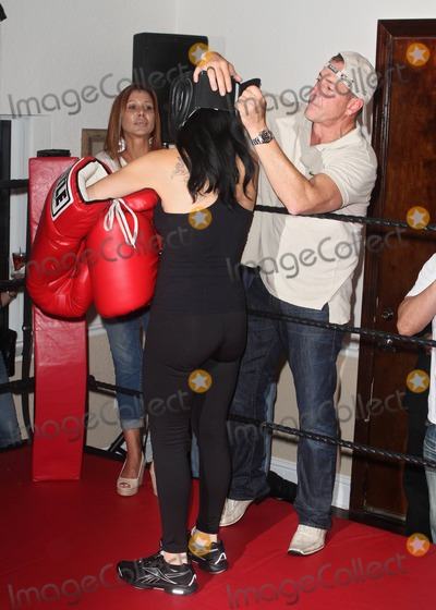 Nadya Octomom Suleman Photo - Michael Lohan attends Nadya Octomom Sulemans boxing match against Cassandra Andersen a South Florida bartender from the Playhouse Gentlemens Club who was chosen from some 1400 wanna be celeb boxers Lohan apparently did not receive an invite to Kim Kardashians wedding like his daughter and ex-wife According to organizers some controversy surrounded the split-decision outcome at the Ocean Manor Resort in Fort Lauderdale Fl 20th August 2011