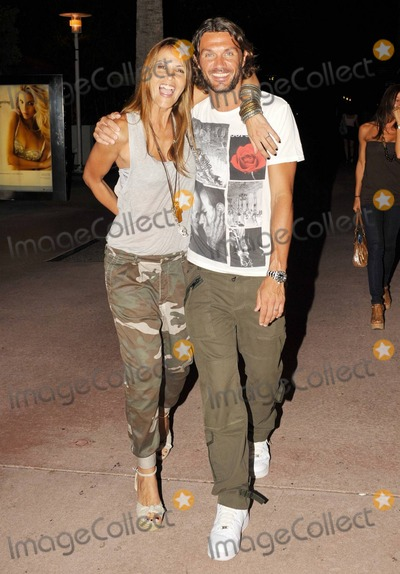 Paolo Maldini Photo - EXCLUSIVE Italian footballer Paolo Maldini and wife Adriana Maldini happily pose for photographers while out for an evening with fellow footballer Alessandro Nesta and his wife Gabriela Pagnozzi on Lincoln Rd Miami Beach FL  070910 Fees must be agreed prior to publication