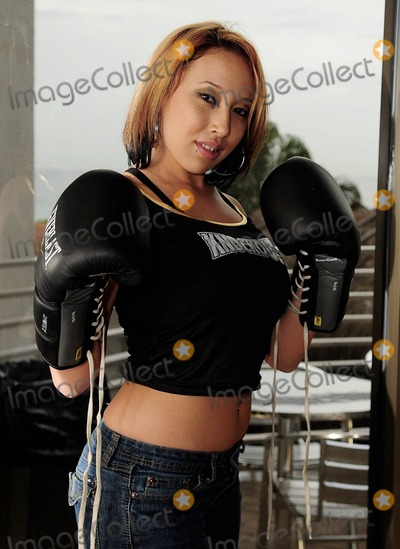 Nadya Octomom Suleman Photo - Nadya Octomom Sulemans opponent Hollywood Gentlemen Club bartender Cassandra Andersen appears at the pre fight conference for the Big Bang Celebrity Boxing Match Press Conference held at Ocean Manor Resort Fort Lauderdale FL 19th August 2011