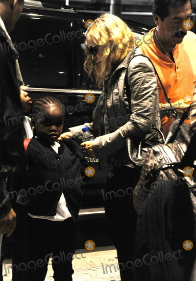 JFK Photo - Madonna her new boyfriend Brahim Zaibat and her children Mercy David and Lourdes arrive at JFK International Airport as they head overseas for a family celebration of Madges 53rd birthday tomorrow New York NY 15th August 2011