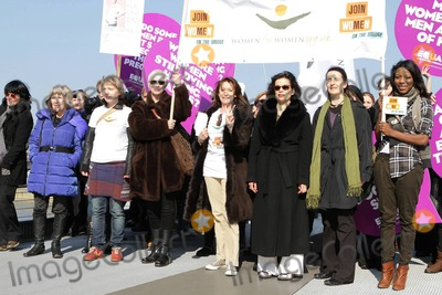 Cheri Lunghi Photo - Jude Kelly Annie Lennox Cheri Lunghi Bianca Jagger and Dr Helen Pankhurst walk side by side with other women carrying signs on Millennium Bridge during the second annual Join me on the Bridge campaign where white doves were released on International Womens Day  Among the women was Dr Helen Pankhurst who said Im honored to be taking part in the Join Me on the Bridge campaign standing strong with women around the world in demanding equality between the sexes as my great-grandmother did 100 years ago referring to Emmeline Pankhurst an English political activist and leader of the British suffragette movement London UK 030811