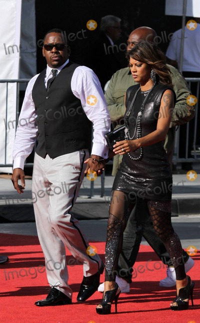 Alicia Etheridge Photo - Bobby Brown gives the peace sign and holds his girlfriend Alicia Etheridges hand as they arrive at the red carpet for the 2010 ESPY Awards held at Nokia Theatre LA Live Los Angeles CA 071410