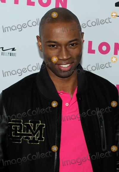 Robbie Jones Photo - Actor Robbie Jones poses for photographers on the red carpet at NYLON magazines 12th anniversary party held at Tru and hosted by the ravishing and beautiful stars of the new epic action fantasy movie Sucker Punch Los Angeles CA 032411