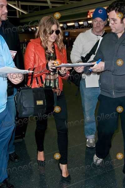 JFK Photo - Black Eyed Peas singer Fergie poses for photos and signs autographs as she heads to her flight at JFK International Airport Fergie who attended Avons 125th anniversary celebration today announced that she will soon launch her second fragrance with Avon called Outspoken Intense The perfume is a follow-up to Outspoken which is Avons best-selling fragrance of all-time New York NY 4611