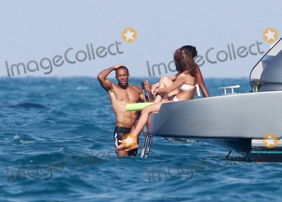 As Four Photo - EXCLUSIVE Naomi Campbell spends the third day enjoying the hi life in Miami cruising around on a yacht  Today the supermodel was joined by UK RB singer Craig David who she has been partying in Miami with  The group of friends which also included Campbells billionaire boyfriend Vladislav Doronin sunbathed jumped into the ocean off of the 59 million Riva 86 Domino super yacht and had fun swimming with an inflatable red Ocean Scooter  The Metallic Ice Domino Yacht features a large sundeck complete with a dining area for six living areas in the cockpit an open sunbed and an air-conditioned upper gallery as well as four comfortably furnished cabins including a master cabin with private en-suite bath The twin MTU engines can hit 38 knots with a cruising speed of 34 The couple were also spotted checking out progress on the construction of Doronins Star Island mansion  Miami Beach FL  032711Fees must be agreed prior to publication