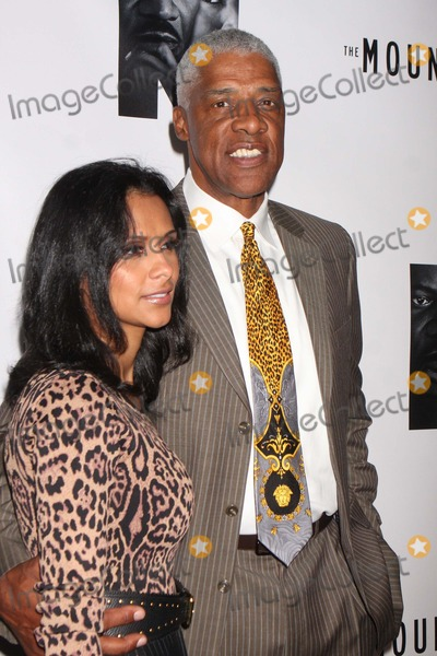 Julius (Dr J) Erving Photo - Julius Dr J Erving and Wife Dorys Madden Erving Arriving at the Opening Night Performance of the Mountaintop at the Bernard B Jacobs Theatre in New York City on 10-13-2011 Photo by Henry Mcgee-Globe Photos Inc 2011