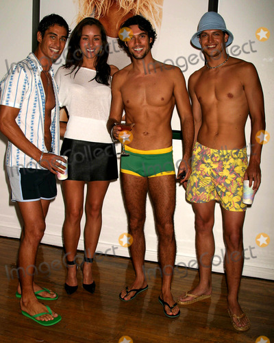 April Wilkner Photo - Andre Resende April Wilkner Daniel Bueno and Carlos Bokelman at Hms Sizzling Swimsuit Event at Hm Soho Loft in New York City on May 12 2004 Photo by Henry McgeeGlobe Photos Inc 2004