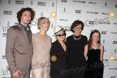 Aaron Johnson Photo - NYC  092110Aaron Johnson (who plays John Lennon) director Sam Taylor-Wood Yoko Ono and Kristen Scott Thomas with unidentified girl at a screening of the new movie Nowhere Boy (the untold story of John Lennon) at the Tribeca Performing Arts CenterPhoto by Adam Nemser-PHOTOlinknet