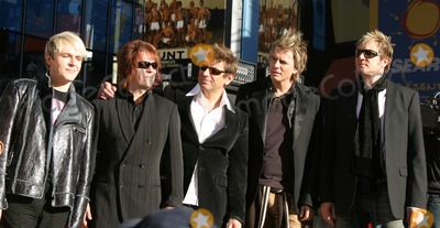 Andy Taylor Photo - NYC  101204Bandmembers of DURAN DURAN Simon Le Bon Nick Rhodes John Taylor Andy Taylor and Roger Taylor performing on Good Morning America in Times SquareDigital Photo by Adam Nemser-PHOTOlinkorg