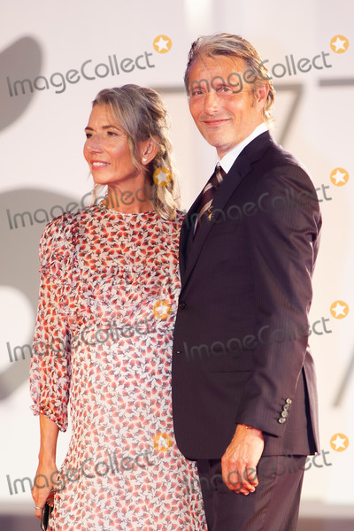 Madness Photo - VENICE ITALY - SEPTEMBER 05 Hanne Jacobsen and Mads Mikkelsen walk the red carpet ahead of the movie Miss Marx at the 77th Venice Film Festival on September 05 2020 in Venice Italy (Photo by Laurent KoffelImageCollectcom)