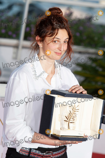 ATL Photo - CANNES FRANCE - MAY 19 Italian director Alice Rohrwacher poses with her trophy on May 19 2018 during a photocall after she jointly won the Best Screenplay prize for the film Lazzaro Felice (Happy as Lazzaro) atl the Palme DOr Winner during the 71st annual Cannes Film Festival at Palais des Festivals on May 19 2018 in Cannes France (Photo by Laurent KoffelImageCollectcom)