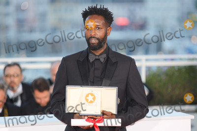 The Jury Photo - CANNES FRANCE - MAY 25 Director Ladj Ly winner of the Jury Price award for his film Les Miserables poses at thewinner photocall during the 72nd annual Cannes Film Festival on May 25 2019 in Cannes France(Photo by Laurent KoffelImageCollectcom)
